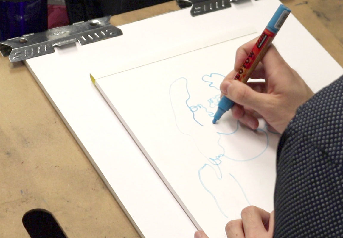 Art Prof TA Casey Roonan draws at a LearnLaunch event